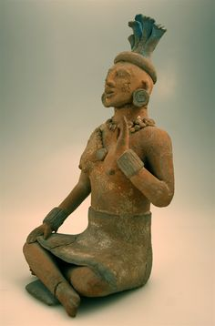 Jaina Style Mayan Terracotta Sculpture of a Seated Woman - DJ.1000  Origin: Jaina, Mexico  Circa: 600 AD to 900 AD