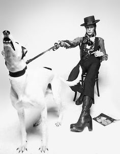 "The dog suddenly got onto its hind legs and began barking.    ""Everyone jumped out of their skins - but Bowie didn't even flinch."" - photographer Terry O'Neill"