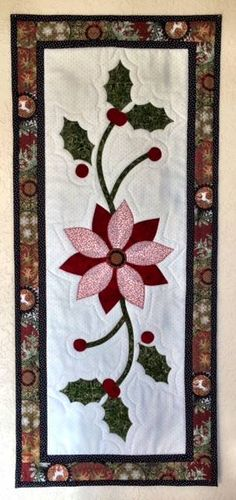 "Nancy Anders' version of the ""Set for the Season"" table runner which appears in American Patchwork & Quilting's Christmas issue. She downloaded this free pattern and made a lovely Christmas gift. Thanks for sharing Nancy!"