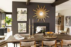 carrier and company modern rustic dining room--dark grey walls, sunburst mirror, industrial table