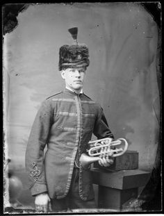 Unnamed bandsman, in uniform of Wanganui Rifle Volunteers, with cornet
