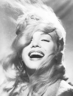 My faves are of those of Marilyn smiling so sweet & happy hearted. Love to all...
