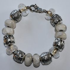 A Trollbeads bracelet using all the new cream beads and the barrels