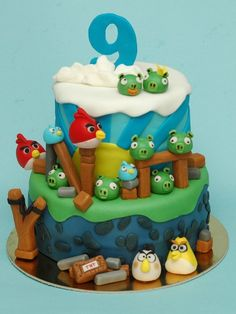 """this cake is based on """"Bella Cupcakes"""" angry birds cake. Her cake is much better, but you can't blame a girl for trying ;)"""