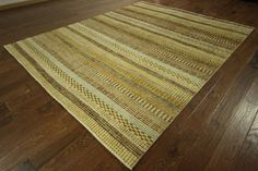 Design: Gabbeh Size: 7 10 X 9 10 Foundation: Cotton Pile : Wool Weave: Hand-knotted Condition: Excellent