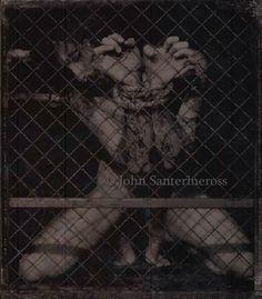 by John Santerineross
