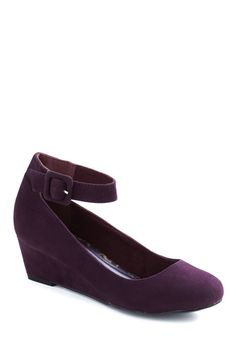 Nice height on the heel, awesome plum color, and sassy ankle strap!