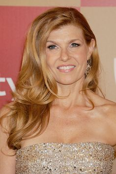 Add lightness and movement to thick hair by opting for a cut like Connie Britton's. Her chin-skimming layers give her style a flattering shape.