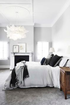 A calming, monochromatic colour scheme was adopted for the master bedroom. The 'Fandango' pendant light is by Hive. Grey Bedroom With Pop Of Color, Wall Decor Bedroom, Bedroom Paint, Bedroom Inspirations, Bedroom Carpet, Grey Room, Gray Bedroom Walls, Bedroom Color Schemes, Pendant Lighting Bedroom