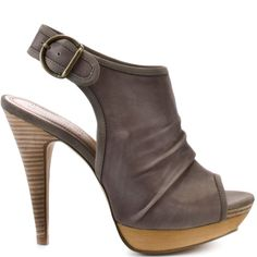 You cant got wrong with this sleek and classic style from Luxury Rebel.  Julie is a ligh grey peep toe sandal with a 4 1/2 inch heel and 1/2 wood platform.  This bootie has an adjustable ankle strap and can be worn from day to night.