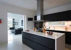 black kitchen cupboards with white benchtops - Google Search