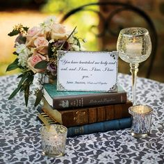 Place a stack of leather-bound books on each table, topped with a framed quote from one of the classic literary picks.