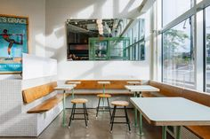 La Firme transforms cramped space into Montreal's sun-lit Melk Cafe Green Windows, Huge Windows, Industrial Coffee Shop, Cafe Bench, Cafe Interior, Interior Design, Built In Seating, Bar Seating, Built In Furniture