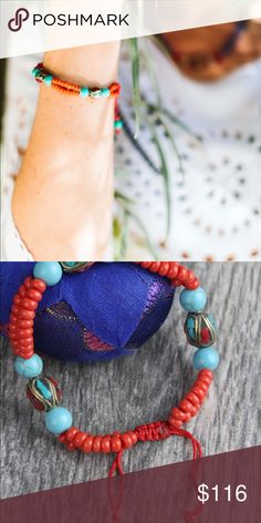 Karma Bracelet with Tibetan Beads Beautiful coral and turquoise wrist mala accented with traditional inlaid Tibetan beads.  Great for stacking or wearing on its own!  Strung on adjustable red cord, this wrist mala fits wrists 5 to 7 inches around.  Includes 8mm turquoise beads, 9mm Tibetan beads, and 5mm coral beads.  Handmade in Kathmandu, Nepal. artisan made Jewelry Bracelets
