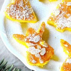 Moist Mini Orange & Saffron Cakes Recipe Desserts with orange, eggs, sugar, saffron, rum, sugar, butter, all-purpose flour, baking powder, orange, powdered sugar, slivered almonds