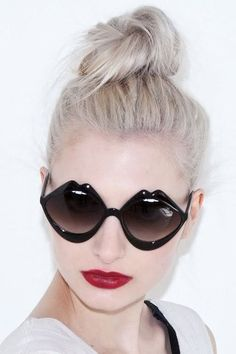 Black Lip Sunglasses pumped up by bold red lips. Loving the look!