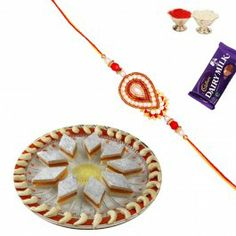 Send #Mithai #Orange Katali with #Zardozi #Rakhi and Shagun at http://www.rakhistoreonline.com/rakhi-with-sweets/orange-katali-sweet-with-zardozi-rakhi-and-shagun.html