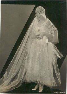 Art Deco bride with juliet cap veil, lace and plenty of tulle. Photo dated May 17th, 1930.