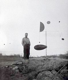 Alexander Calder with Steel Fish, Roxbury, 1934.   Photograph by James Thrall Soby.