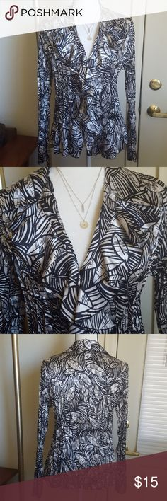 V-Neck Ruffle Long Sleeve Shirt Very cute ruffle shirt, perfect for fall with all the leaves design. Bought from another Posher but decided it is not for me. 100% polyester. EUC. Notations Tops Button Down Shirts