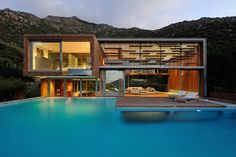 Luxury Spa House in Hout Bay, South Africa,  I love the transparency and the inside flows to the outside.