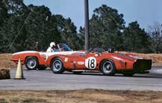 Graham Hill in his Ferrari 330 TRI/LM managed to avoid contact with the Ford-powered Sabra Sports of Edmund Hessert, Jr. in the Hairpin. Sebring 1963