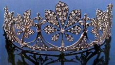 An earlier belle epoque tiara in the shape of five chestnut leaves, with smaller diamond spacers.