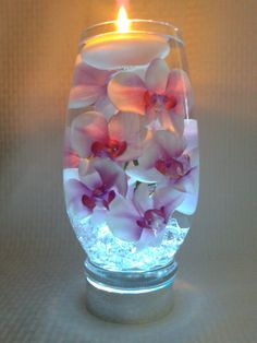 Pink Orchids With Purple Centers Float In A 10 Inch Glass Vase Filled With Water Perfect For Wedding Reception Centerpieces Or Home Decor - Haus Dekoration Floating Candle Centerpieces, Wedding Reception Centerpieces, Diy Candles, Floral Centerpieces, Wedding Table, Floral Arrangements, Wedding Decorations, Hanging Candles, Wedding Arrangements