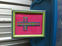 """Upcycled studded wild color belt made cross.  Added also to trim out frame.  8X10"""" bright colors , hot pink / lime zebra print w/ blue studs.  So cool.  $18.00"""