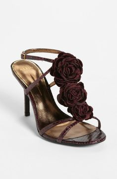 Dark roses decorate a pretty sandal