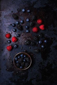 Chiaroscuro style raspberries, blackberries, and blueberries. Raspberries are by far my favorite fruit/flavor/everything.