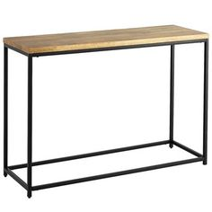 "Named for the Hindi word meaning ""strength"" or ""stamina,"" our Takat Collection makes a powerful statement. The sturdy black iron frame, clean lines and warm mango wood tabletop are at home almost anywhere, whether the rest of your carefully curated decor is industrial chic or modern minimalist. And thanks to natural variations in the wood, each tabletop is subtly unique and different—like you. A powerful statement, indeed."