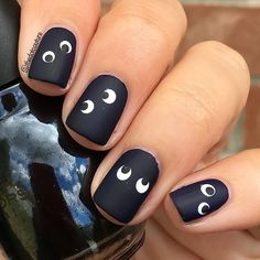 Spooky matte google-eye monster Halloween nail art.