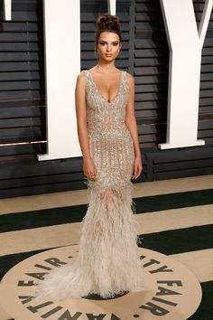 Emily Ratajkowski wore a sparkling sheer silver dress by Jonathan Simkhai to the 2017 Vanity Fair Oscars after party.