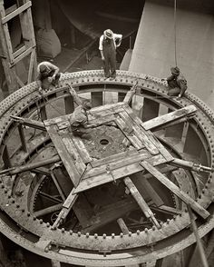 """June 1942. """"Installation of a third 30,000 kilowatt generator at the Tennessee Valley Authority's Cherokee Dam on the Holston River."""" Medium format safety negative by Arthur Rothstein for the Office of War Information."""