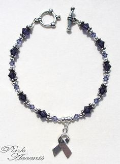 Alzheimer's Disease Awareness: Two-Toned Purple Swarovski Crystal and Sterling Silver Plated Bracelet, 8.50 inches.  30% of the purchase price goes directly to the Alzheimer's Action Foundation of New York, to support Alzheimer's research!