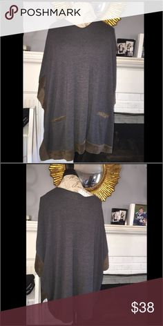 Swedes combo tunic style top. Vendor sample Amazing material swede combo NWT only used as a vendor sample in perfect condition with tags still attached. Cannot use vendor name due to current line. vendor sample. cannot list Tops