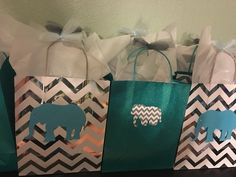 Our prize bags for the baby shower games. Bags were from Target and our elephant cut outs. Went perfect with our theme!