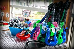 "inflatable guitars + kanye shades = adorable ""rockstar"" party favors"