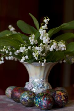 Easter eggs in front of Lily-of-the-valley flowers by Panayotis Pantzartzidis, via 500px