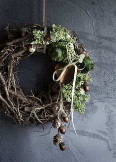 Fall Twig Wreath with acorns, ribbon, pine cones and seed pods.