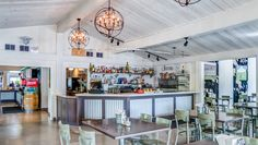 The Grove Restaurant Dining Area, Hollister, Liquor Cabinet, Photo Wall, Indoor, Restaurant, Table, Furniture, Home Decor