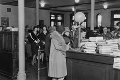 Library patrons wait to check out materials at the Salt Lake City Free Public Library on Jan. 14, 1930. In 1965, the building became the Hansen Planetarium. It currently houses the O.C. Tanner Company Headquarters. Courtesy  |  Utah State Historical Society Library