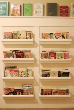 Rain gutter shelves for kid's books via Barefoot In The Kitchen.  Brilliant!