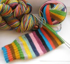 Mind the Gap by Trailing Cloud Yarns: self-striping yarn dyed in the iconic palette of the London Underground lines.