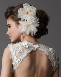 updo with large floral accessories