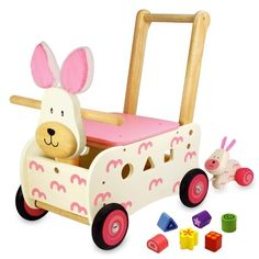 The Walk & Ride Rabbit Sorter features a sturdy rabbit ride on walker with easy grip handle, shape sorting body, shape sorting blocks, handy storage, and a pull-along baby rabbit Mths). Artiwood Educational Toys and Wooden Puzzles Kids Ride On Toys, Kids Toys, Wooden Puzzles, Wooden Toys, Organic Baby Toys, Wooden Rabbit, Easter Toys, Rabbit Baby, Activity Toys