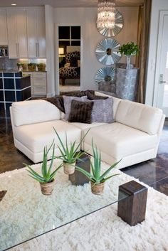 white furniture. Glass coffee table
