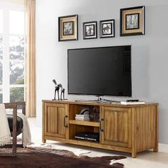 This Rylan Natural Wood TV Media Cabinet balances style and function effortlessly, providing organization. Its light wood finish is sure to enrich your space! Space Furniture, Cool Furniture, Painted Furniture, Furniture Cleaning, Furniture Ads, Furniture Removal, Roots Tv, Solid Wood Tv Stand, Media Cabinet