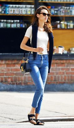 Alexa Chung in high-waisted skinny jeans, a white tea, and Birkenstocks.
